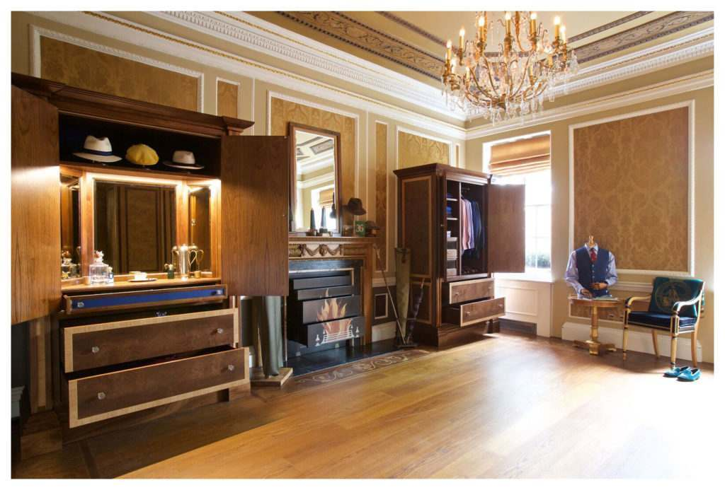 2 walnut cabinets, bespokely made by Clive Christian, filled with Cordings accessories and menswear.
