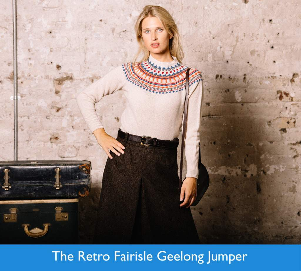 Female model wearing cream jumper with blue and orange geometric pattern with brown herringbone tweed culottes.