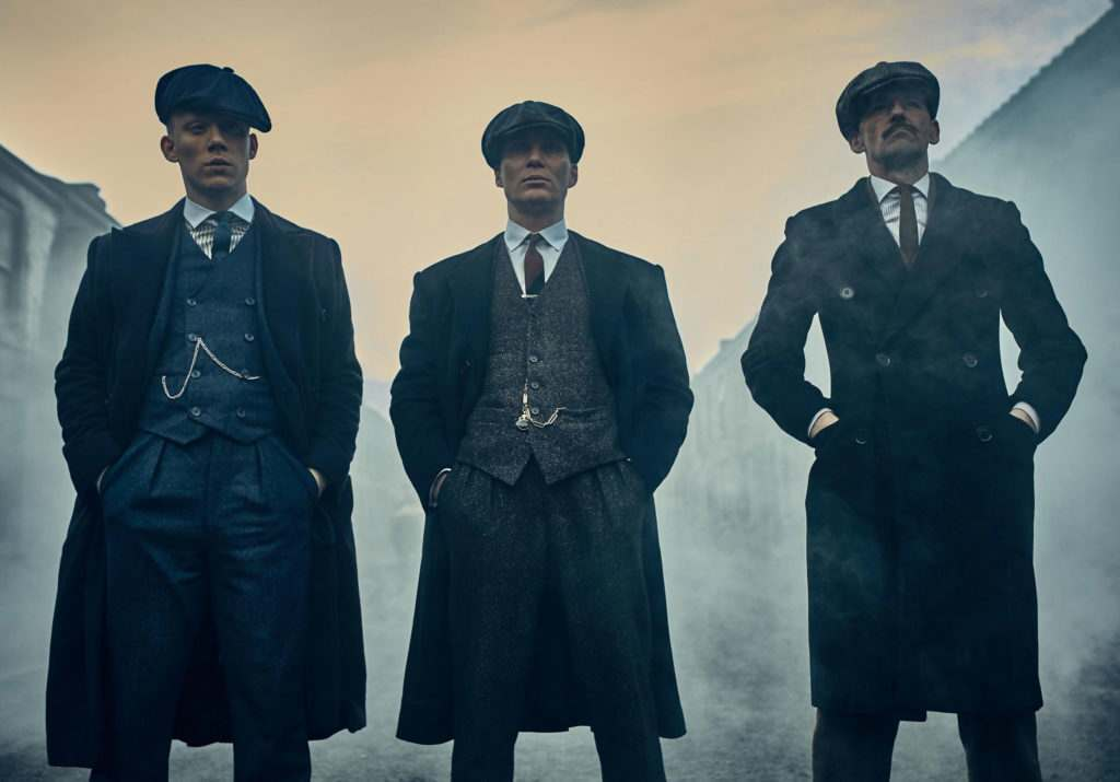 peaky blinders cast wearing tailored tweed suits and serge coats