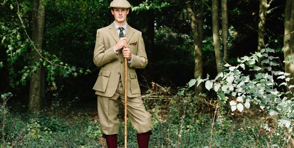 Field enthusiast posing in house check action back jacket with plus fours shooting breeks