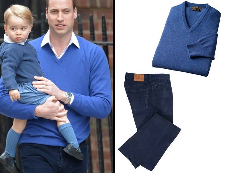 Prince Charles holding Prince George, both wearing matching blue v-neck jumpers