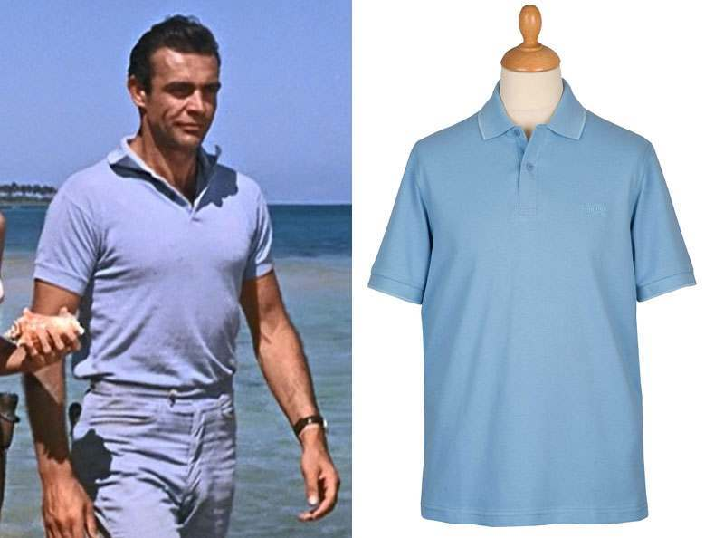 Sean Connery wearing blue polo shirt & blue trousers on a beach, alongside a blue polo on a mannequin