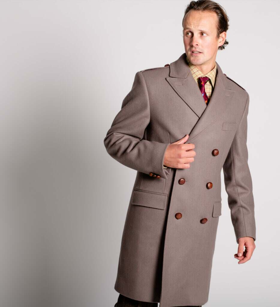 A model wears a double breasted British warm coat by Cordings